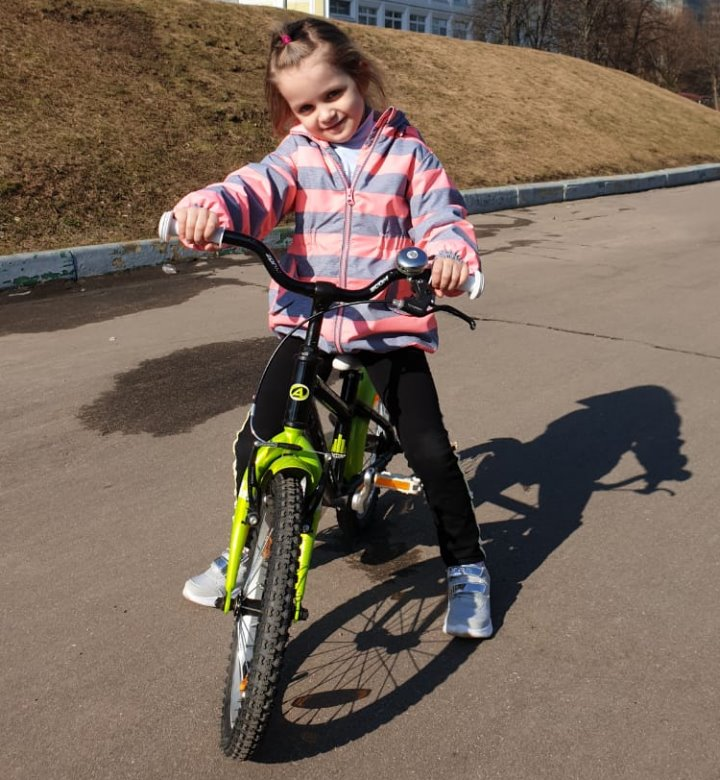 Alice is learning to ride her bike.