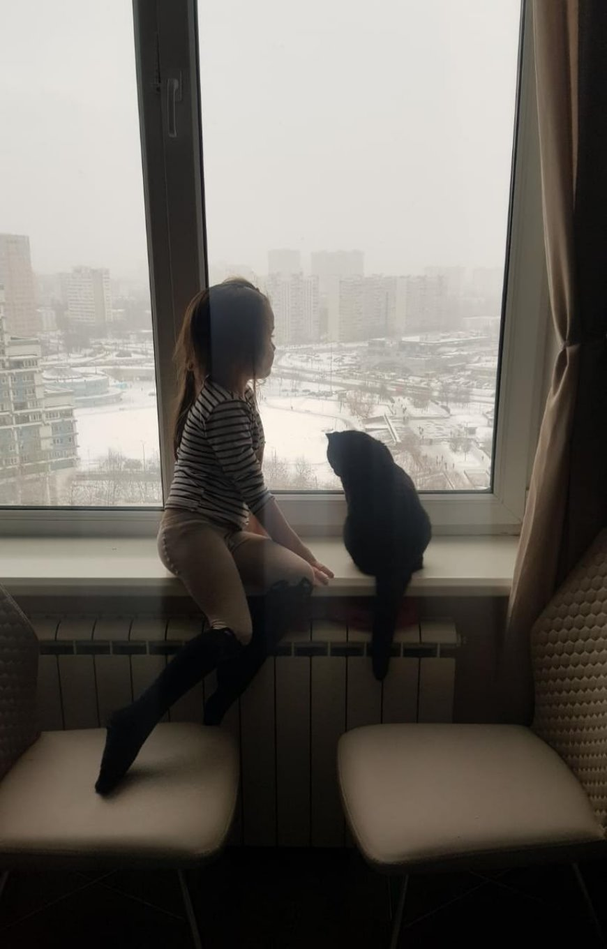 Me and Buggie looking out the window